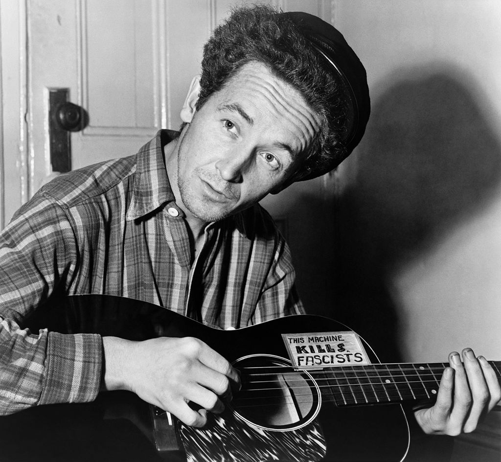 "Woody Guthrie ""This Machine Kills Fascists"""